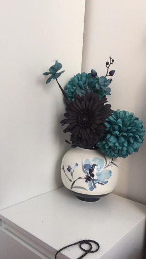 Teal vase with flowers