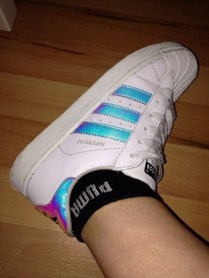 white and multi coloured adidas trainers