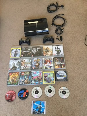 PS3 with 25+ games,Backwards compatible, 2 controllers with 2 chargers (1 new)