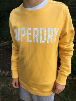 Yellow Superdry jumper.