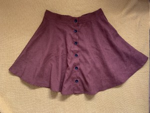 Maroon, mid thigh length skirt. 37 cm waistline. Medium