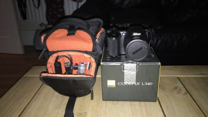Nikon Coolpix L340 comes with USB cable and mini tripod