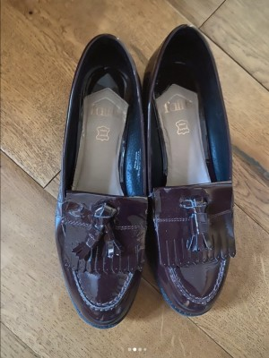Maroon pair of loafers
