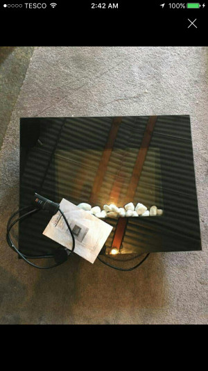 Small wall mounted fire
