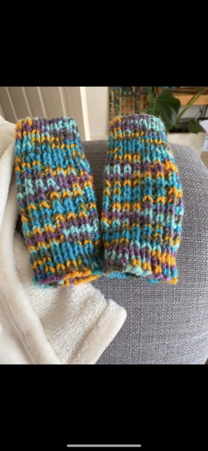 Colourful knitted fingerless gloves