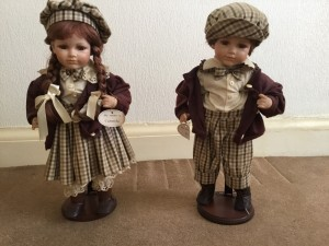 PAIR OF PORCELAIN DOLLS