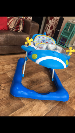 Mothercare baby boy plane ✈️ walker for sale. Bought for £55. Has spinning propellers, a moving steering wheel, horn which makes noise and a spinning ball which makes a plane noise! It has been cleaned and comes from a smoke free home, also has 3 hight set