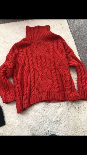 Bright red cable knit jumper