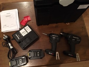 Panasonic combi / hater drill & impact driver brushless 18 v with 5.0ah battery's x2 charger & tanos case .