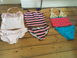 Blue swimming costume from Debenhams aged 11-12 yrs and other two from Next aged 13-14yrs all in god condition!
