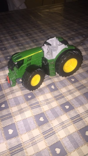 John deer tractor.     Looking around £500 this cost me £1000 in a tractor run this is metal and very rare