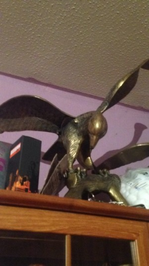 3  brass eagles  good condition