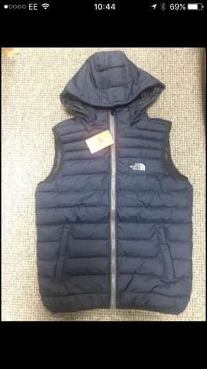 Navy blue north face body warmer