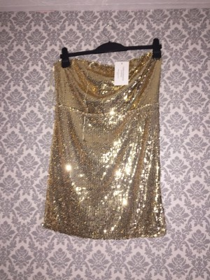 Brand new in the style gold strapless dress size 12