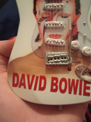 David Bowie mini guitar. Small crack otherwise in great condition