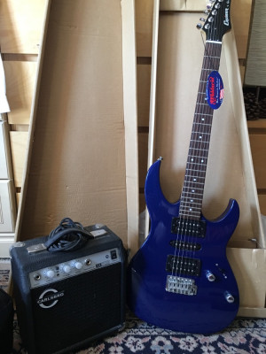 Electric guitar with amp as new