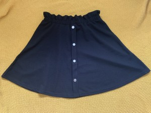 Black skirt, elasticated waist. Mid thigh length. Medium/ large