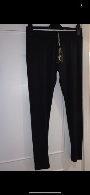 Urban Angel black leggings with button ankle details on back of legs,