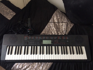 Casio keyboard comes with headphones, music sheet stand and charger