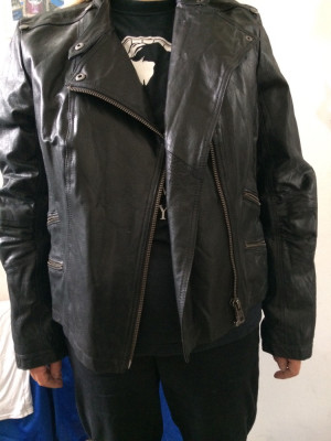 Women's biker-style real leather jacket. Mint condition. Ladies size 20. Hardly used. Stylish and beautifully made. Zipped pockets.