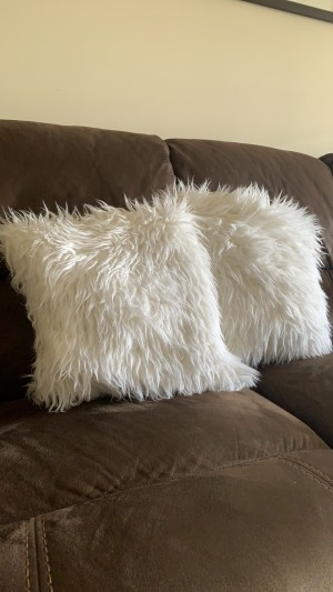 Two large fluffy white cushions
