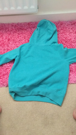 Turquoise jumper with 63 in sequins. From next. 10 years