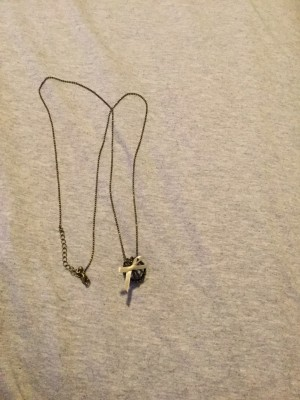 Ladies Long Necklace With A Black Bell Pendant
