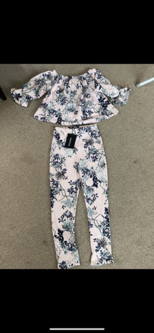 Pretty Little Things dusty pink floral cropped trousers and Bardot