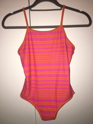 Orange and pink striped swimsuit from f&f age11-12 but will fit a size 6. Has never been worn and still has the hygiene sticker on the inside £4