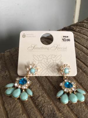 Woman's beautiful brand new earrings