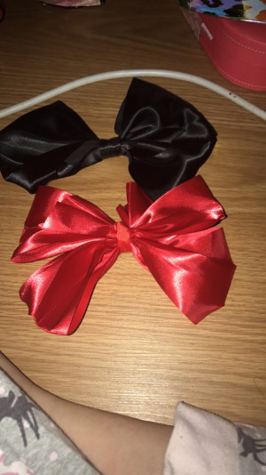 2 bows 1 black and 1 red