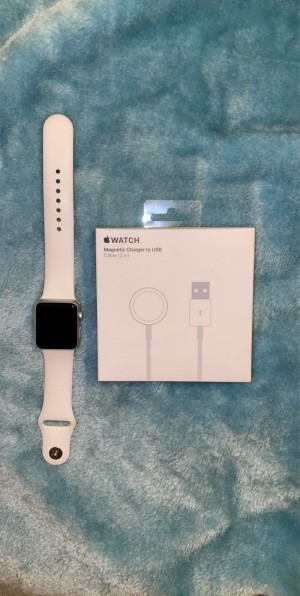 Series 2 apple watch with white strap and brand new magnetic charger