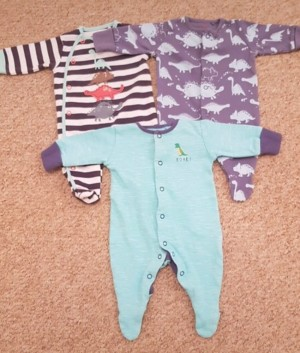 3 Dinosaur sleepsuits by Next. Up to 1 Month