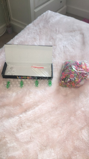 Loom bands from Argos over 600 different coloured bands.includes 9 loom hooks,round about 309 s clips. £20