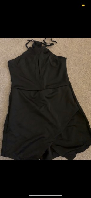 Halter neck black playsuit with front slit and asymmetric panelling