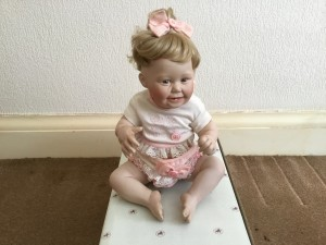 ASHTON DRAKE PORCELAIN DOLL CUTE AS A BUTTON.