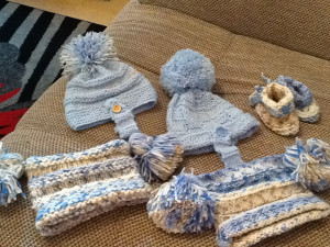 Hand knitted newborn baby hats and booties