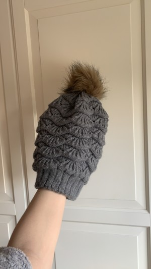 Grey knitted bobble hat with faux fur bobble