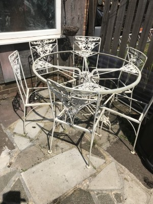 Cast iron garden table and six chairs with glass