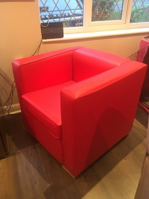 Red leatherette armchair for office or man cave. 1 year old in immaculate condition.
