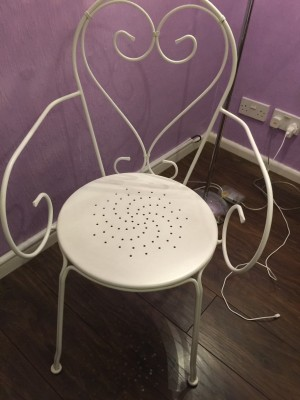 2 white metal chairs