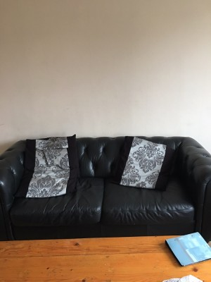 2 seats and 2 single black leather sofa in good conditions