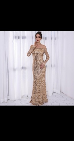 A golden wow-factor dress that can be worn for a party, wedding , baby