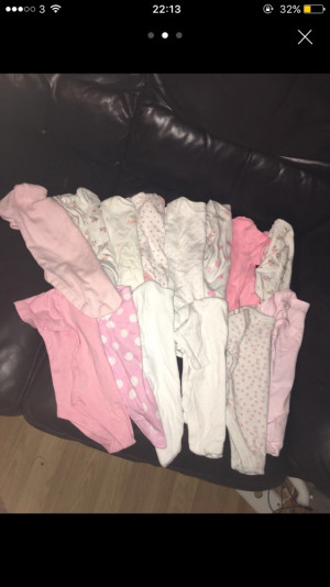 Baby girls vests and baby grows.