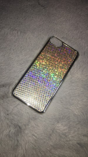 A mermaid scale phone case. Available for iPhone 6/6s. Perfect conditi