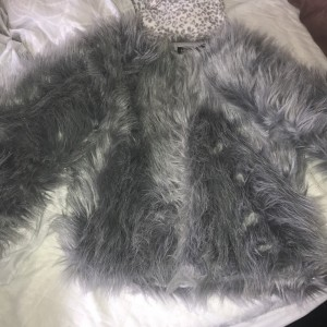 Grey fur coat size m but will fit 6/8