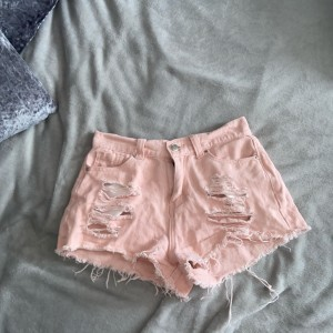 Pink denim ripped shorts