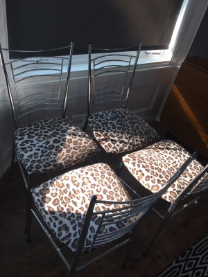 4 leopardskin chairs