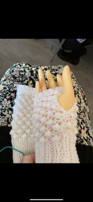 White fingerless knitted wool gloves