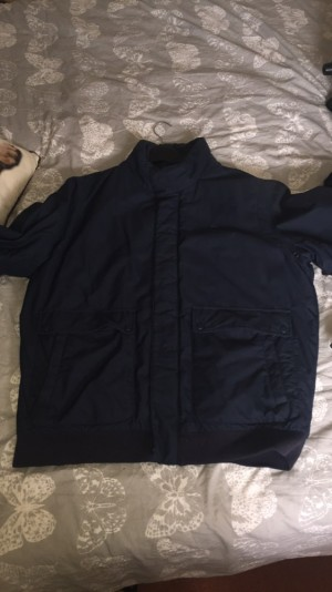 Men's Lacoste coat/jacket size 7. Excellent condition in navy blue